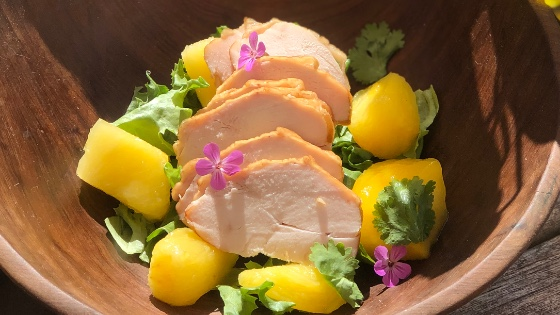 Smoked Chicken and Mango Salad with edible flowers
